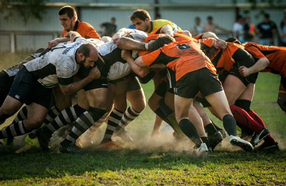 Rugby players in active scrum