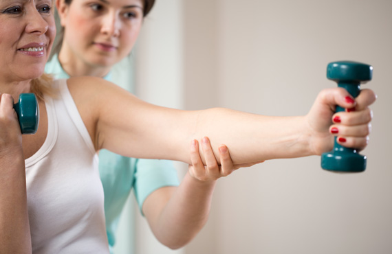 Woman in osteoperosis physical therapy session