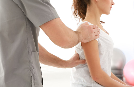 Physiotherapist working on shoulder