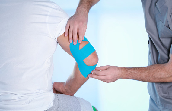 Physiotherapist applying elbow wrap