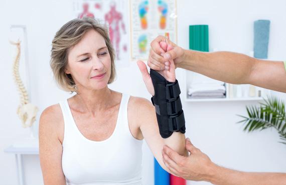 Physiotherapist conducting wrist session